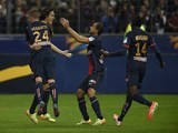 Paris' Uruguayan forward Edinson Cavani (2nd R) celebrates with teammates after a goal against Lyon on April 19, 2014