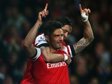 Olivier Giroud of Arsenal (R) celebrates with Tomas Rosicky as he scores their second goal during the Barclays Premier League match against West Ham United on April 15, 2014