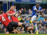 Manchester United's English defender Phil Jones (Far L) handles the ball off a shot from Everton's Belgian striker Romelu Lukaku (R) which results in a penalty during the match on April 20, 2014