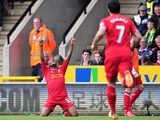 Liverpool's Raheen Sterling celebrates after scoring his team's third goal against Norwich during the Premier League match on April 20, 2014