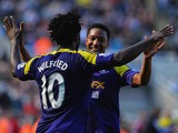 Wilfried Bony of Swansea City celebrates with Jonathan de Guzman of Swansea City as he scores their first goal during the Barclays Premier League match between Newcastle United and Swansea City at St James' Park on April 19, 2014
