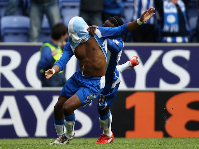 Charles N'Zogbia of Wigan Athletic celebrates with Victor Moses after scoring the winning goal during the Barclays Premier League match against Arsenal on April 18, 2010