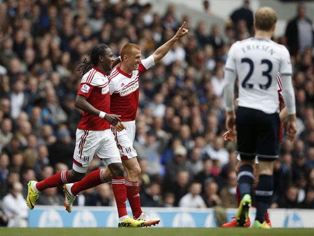 Fulham's English midfielder Steve Sidwell celebrates scoring their first goal to equalise during the English Premier League football match between Tottenham Hotspur and Fulham at White Hart Lane in north London on April 19, 2014