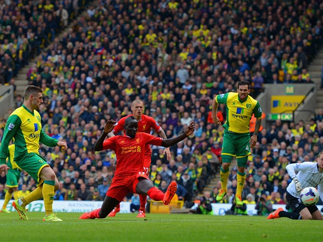 Norwich's Gary Hooper scores his team's first goal against Liverpool during the Premier League match on April 20, 2014