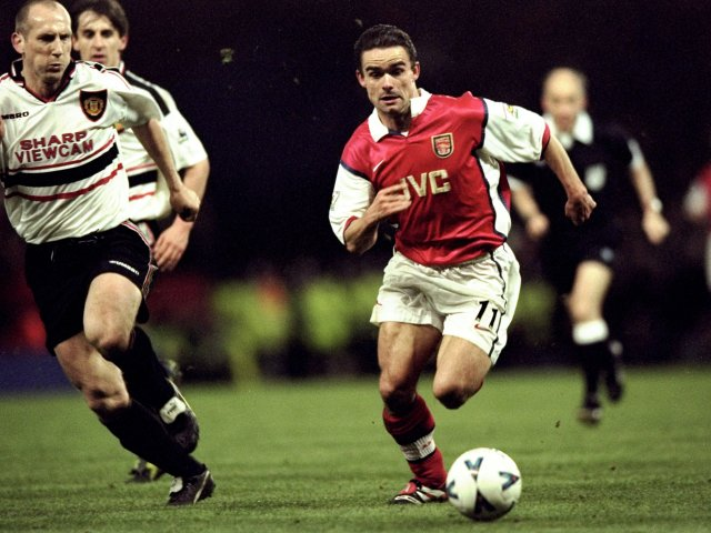 Marc Overmars, then of Arsenal, in possession of the ball against Manchester United on April 14, 1999.