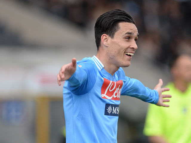 Napoli's Maria Callejon celebrates after scoring the opening goal against Udinese during the Serie A match on April 19, 2014