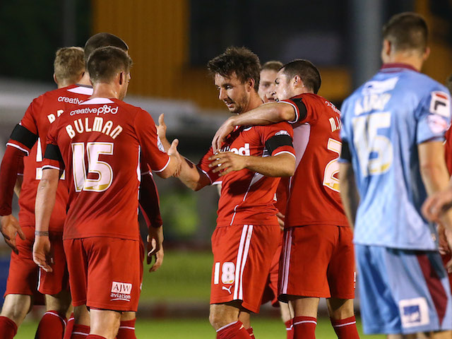 Matt Tubbs of Crawley (R) celebrates his goal with teammate Dannie Bulman during the Sky Bet League One match against Tranmere Rovers on April 15, 2014