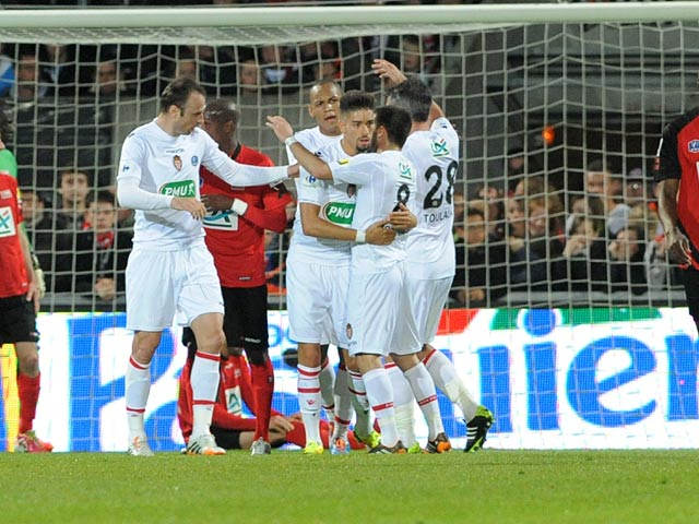 Monaco players celebrate after scoring against Guingamp during the French Cup semi-final match on April 16, 2014