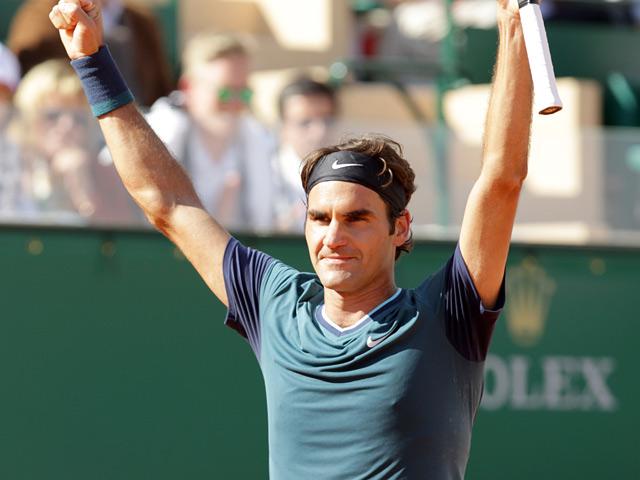 Roger Federer celebrates after beating Novak Djokovic during the Monte Carlo Masters match on April 19, 2014n