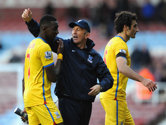 Tony Pulis manager of Crystal Palace with Yannick Bolasie of Crystal Palace after the Barclays Premier League match against West Ham United on April 19, 2014