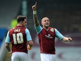 Michael Kightly of Burnley celebrates scoring their second goal during the Sky Bet Championship match between Burnley and Wigan Athletic at Turf Moor on April 21, 2014