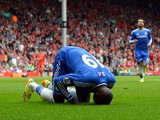 :Chelsea's French-born Senegalese striker Demba Ba celebrates after scoring the opening goal during the English Premier League football match between Liverpool and Chelsea at Anfield Stadium in Liverpool, northwest England, on April 27, 2014