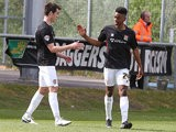 Northampton's Ivan Toney is congratulated by teammate John Marquis after scoring his team's third goal against Dagenham & Redbridge in the League Two match on April 26, 2014