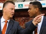 Louis van Gaal and Patrick Kluivert stand on the touchline before a Netherlands match on November 14, 2012.