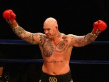 Lucas Browne celebrates after he defeated James Toney in the WBC Super Heavyweight bout on April 28, 2013