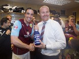 Burnley captain Michael Duff and manager Sean Dyche celebrate promotion to the Premier League on April 21, 2014