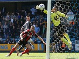 Martyn Woolford of Millwall beats Steve Cook of Bournemouth to the ball to score their first goal of the game during the Sky Bet Championship match on May 3, 2014