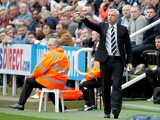 Newcastle United manager, Alan Pardew makes arare appearance out out of the dug-out during the Barclays Premier League match between Newcastle United and Cardiff City at St. James' Park on May 03, 2014