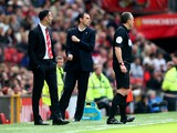 Gustavo Poyet the Sunderland manager celebrates as his team take a 1-0 lead during the Barclays Premier League match between Manchester United and Sunderland at Old Trafford on May 3, 2014