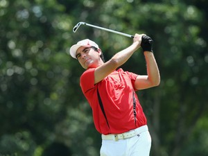 Felipe Aguilar of Chile hits his tee-shot on the fifth hole on day two of The Championship at Laguna National held at Laguna National Golf & Country Club on May 2, 2014
