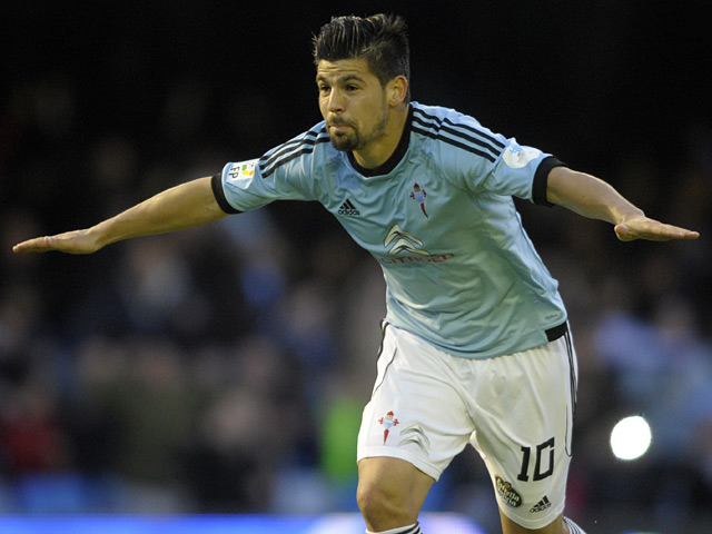 Celta Vigo's Nolito celebrates after scoring against Sevilla during the La Liga match on March 29, 2014