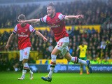 Carl Jenkinson of Arsenal celebrates scoring the second goal during the Barclays Premier League match between Norwich City and Arsenal at Carrow Road on May 11, 2014