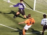 Dennis Bergkamp scores for Holland against Argentina on July 04, 1998.