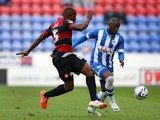 Wigan's Marc-Antoine Fortune and QPR's Nedum Onuoha in action during the Championship play-off first leg match on May 9, 2014