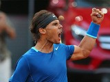 Rafael Nadal celebrates after winning a point against Kei Nishikori during the Madrid Masters final on May 11, 2014