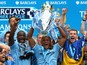 Vincent Kompany of Manchester City lifts the Premier League trophy at the end of the Barclays Premier League match between Manchester City and West Ham United at the Etihad Stadium on May 11, 2014