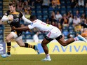 Elliot Daly of London Wasps tackled by Waisea Vuidravuwalu of Stade Francais Paris during the European Rugby Champions Cup play-off first leg match on May 18, 2014
