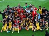 Atletico de Madrid's football players and staff pose as they celebrate their Spanish league title at the end of the Spanish league football match FC Barcelona vs Club Atletico de Madrid at the Camp Nou stadium in Barcelona on May 17, 2014
