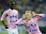 Evian's Danish defender Daniel Wass jubilates after scoring a goal during the French L1 football match Sochaux (FCSM) against Evian (ETGFC) on May 17, 2014