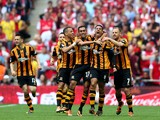 Curtis Davies of Hull City celebrates with team mates as he scores their second goal during the FA Cup with Budweiser Final match between Arsenal and Hull City at Wembley Stadium on May 17, 2014