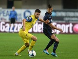 Ivan Radovanovic (L) of Chievo Verona competes with Saphir Slitti Taider of Internazionale Milano during the Serie A match on May 18, 2014