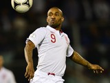 England's Jermain Defoe eyes the ball during the World Cup 2014 qualifying football match between San Marino and England at Serravalle Stadium in San Marino on March 22, 2013