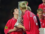 Robbie Fowler and Sami Hyypia of Liverpool kiss the trophy after victory in the UEFA Cup Final against Deportivo Alaves on May 16, 2001
