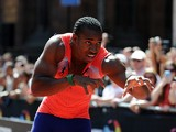 Yohan Blake of Jamaica celebrates winning the Men's 150 Metres during the Great City Games In Manchester on May 17, 2014