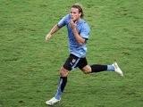Former Manchester United striker Diego Forlan celebrates scoring Uruguay on July 07, 2007.
