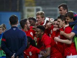 Players of England celebrate after the UEFA U17 Championship Qualifier Elite Round match between Italy and England on March 31, 2014