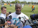 Ja'Wuan James #72 of the Miami Dolphins answers questions from the media after the rookie minicamp on May 23, 2014