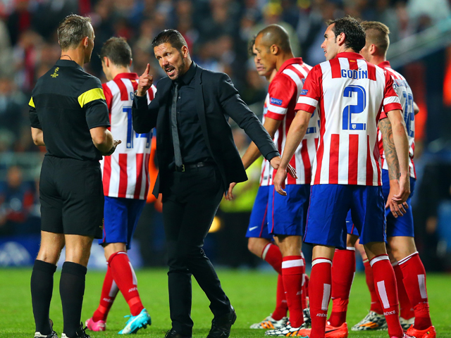 Diego Simeone, Coach of Club Atletico de Madrid speaks to Referee Bjorn Kuipers during the UEFA Champions League Final between Real Madrid and Atletico de Madrid at Estadio da Luz on May 24, 2014