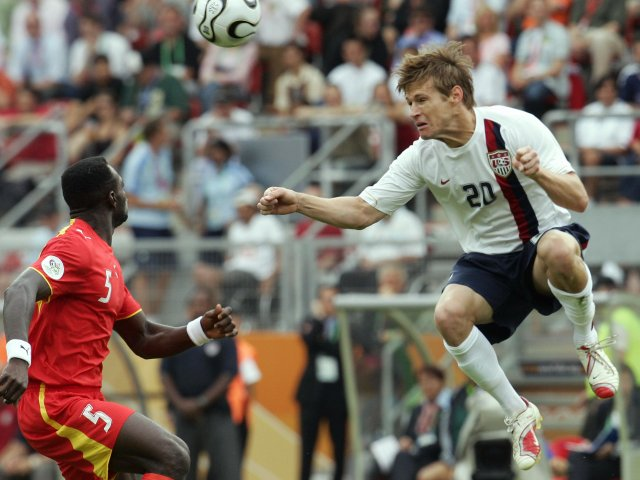 USA striker Brian McBride leaps to head the ball against Ghana on June 22, 2006.