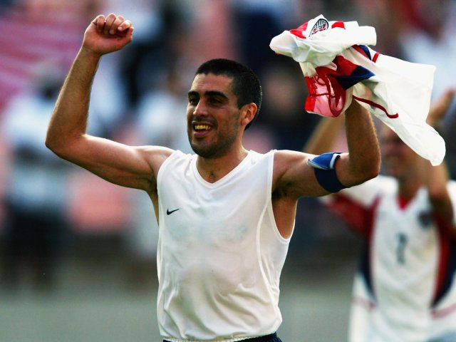 Former Rangers midfielder Claudio Reyna celebrates scoring for the USA at the World Cup on June 17, 2002.