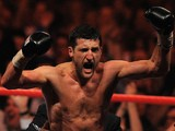 Carl Froch of Britain celebrates after beating Lucian Bute of Romania during their IBF World Super Middleweight Title boxing match in Nottingham central England on May 26, 2012