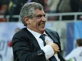 Greece manager Fernando Santos celebrates his side scoring a goal on November 19, 2013.