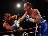 James DeGale (L) of England fights George Groves of England in the British and Commonwealth Super-Middleweight Championship during World Championship Boxing on May 21, 2011