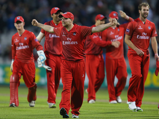 Karl Brown of Lancashire Lightning celebrates victory during The Natwest T20 Blast match between Lancashire Lightning and Birmingham Bears at the Emirates Old Trafford Ground on May 30, 2014