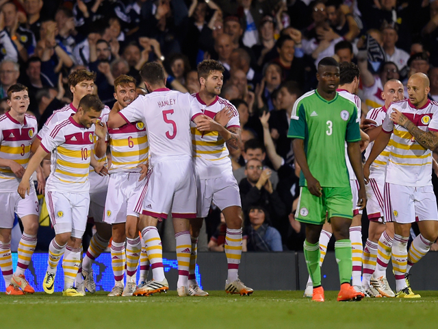 Scotland players celebrate after an own goal by Azubuike Egwuekwe of Nigeria during an International Friendly between Scotland and Nigeria at Craven Cottage on May 28, 2014