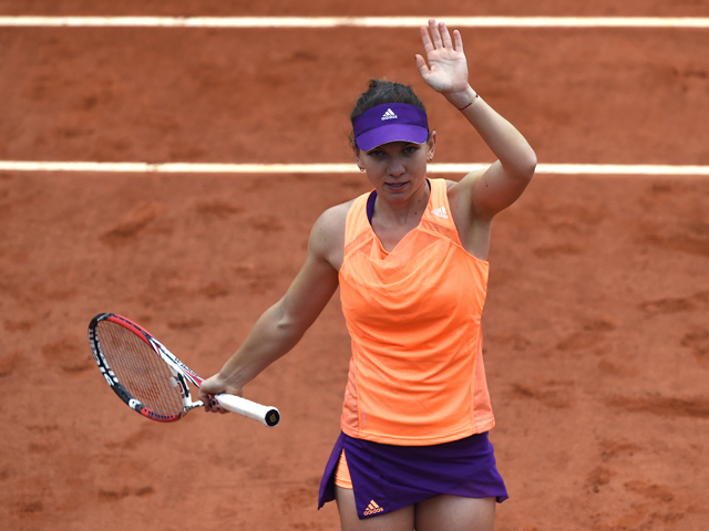 Romania's Simona Halep celebrates after winning her French tennis Open second round match against Great Britain's Heather Watson at the Roland Garros stadium in Paris on May 29, 2014